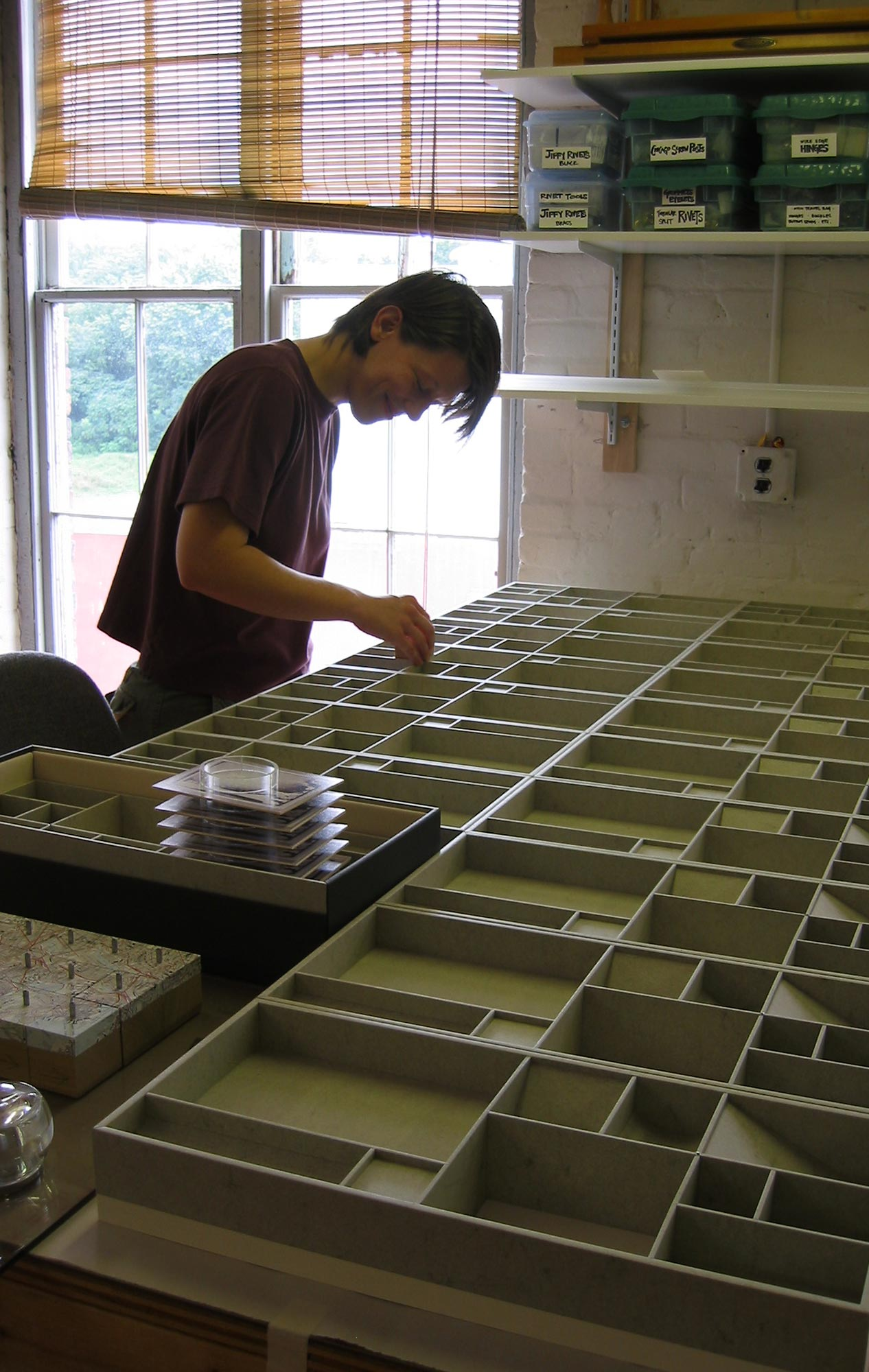 Former crew member Erin Clay Nelson working on the boxes for <i>Surplus Value Books,</i> a collaboration with Indulgence Press.